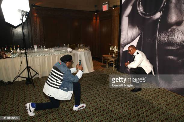 Film Director Presenter Spike Lee takes a photo of Honoree Documentary photographer Jamel Shabazz backstage at Gordon Parks Foundation 2018 Awards...
