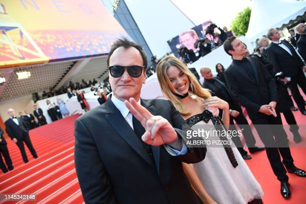 TOPSHOT US film director Quentin Tarantino and Australian actress Margot Robbie arrive for the screening of the film Once Upon a Time in Hollywood at...