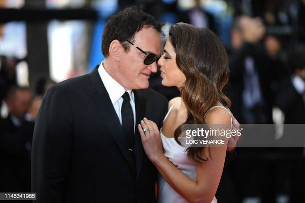 TOPSHOT US film director Quentin Tarantino and his wife Israeli singer Daniella Pick arrive for the screening of the film Once Upon a Time in...