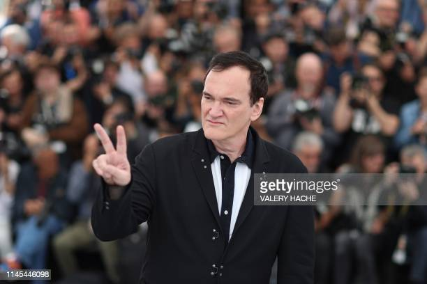 US film director Quentin Tarantino flashes the victory sign during a photocall for the film Once Upon a Time in Hollywood at the 72nd edition of the...