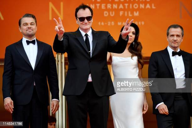 US film director Quentin Tarantino flashes the victory signs as he arrives with his wife Israeli singer Daniela Pick US actor Leonardo DiCaprio and...