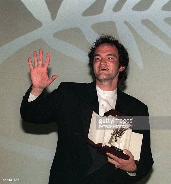 US film director Quentin Tarantino poses 23 May 1994 with the Golden Palm he was awarded for his film 'Pulp Fiction' at the 47th Cannes International...