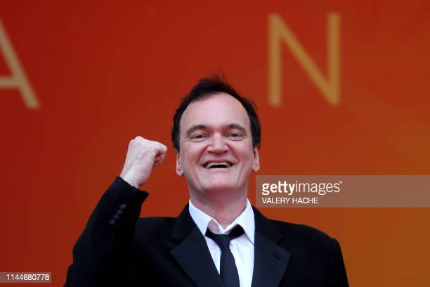 "Film director Quentin Tarantino poses as he arrives for the screening of the film ""The Wild Goose Lake "" at the 72nd edition of the Cannes Film..."