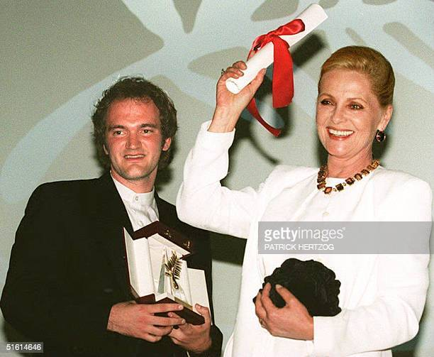 Film director Quentin Tarantino poses with the Golden Palm he was awarded 23 May 1994 for Pulp Fiction next to Italian movie star Virna Lisi who was...