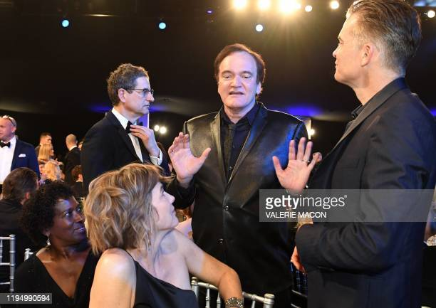 US film director Quentin Tarantino speaks with US actor Timothy Olyphant and guests during the 26th Annual Screen Actors Guild Awards show at the...