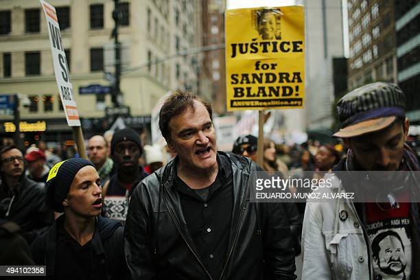 US film director Quentin Tarantino takes part in a march against police brutality called 'Rise up October' on October 24 in New York Campaigners...
