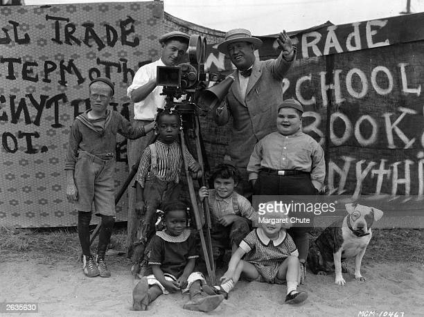 Film director Robert McGowan and cinematographer Art Lloyd seen with the child stars of his 'Our Gang' film series otherwise known as the 'Little...