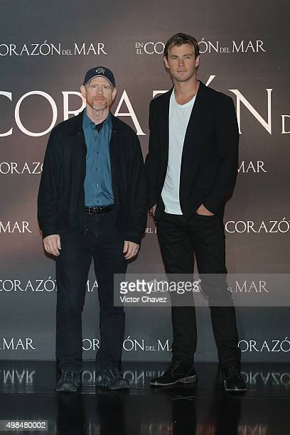 Film director Ron Howard and actor Chris Hemsworth attend a photo call and press conference to promote the new film 'In the Heart of the Sea' at St...