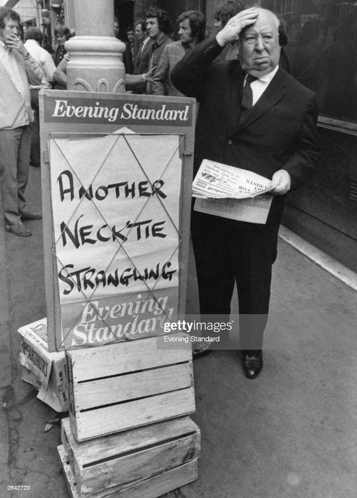 Film director Sir Alfred Hitchcock (1899 - 1980) buys a copy of the Evening Standard, with a chilling headline, 26th July 1971. He is in London publicising his latest film 'Frenzy', in which a serial killer uses a necktie to strangle his victims.