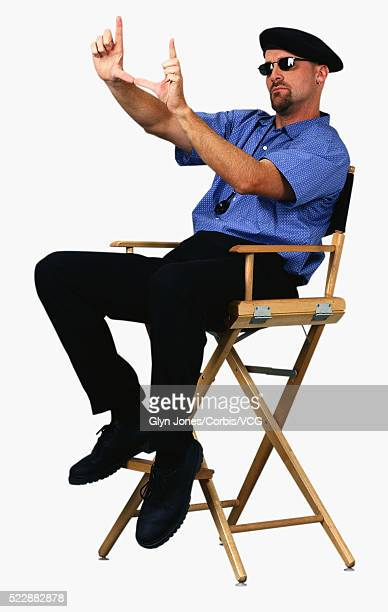 Film Director Sitting in his Director's Chair