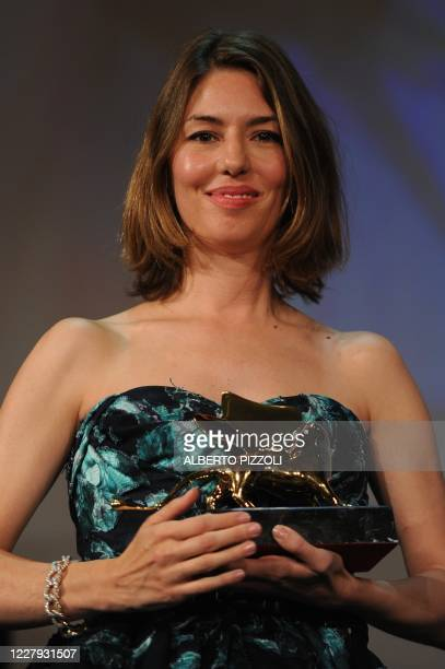 """Film director Sofia Coppola holds the Golden Lion she received for his film """"Somewhere"""" during the awards ceremony of the 67th Venice film festival..."""