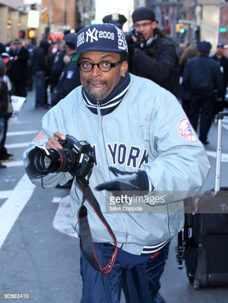 Film director Spike Lee takes pictures of fans at the 2009 New York Yankees World Series Victory Parade on November 6 2009 in New York City