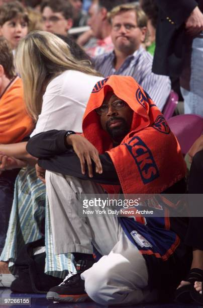 Film director Spike Lee watches from the sideline as the New York Knicks take on the Indiana Pacers in the Eastern Conference finals at Madison...
