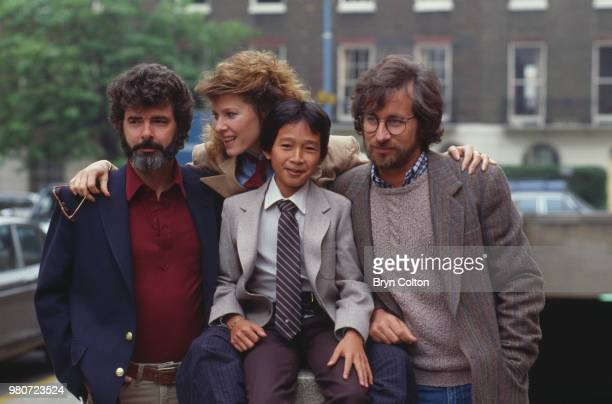 Film director Steven Spielberg right poses for a photograph with left to right executive producer George Lucas actress Kate Capshaw and actor...