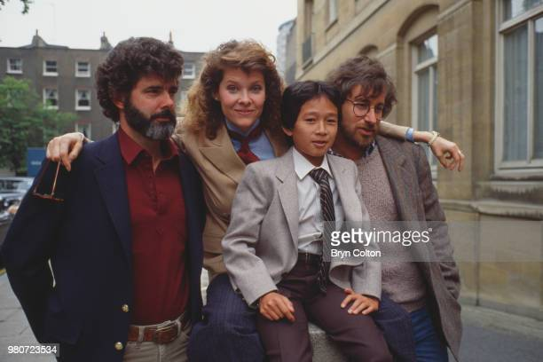 Film director Steven Spielberg, right, poses for a photograph with, left to right, executive producer George Lucas, actress Kate Capshaw, and actor...