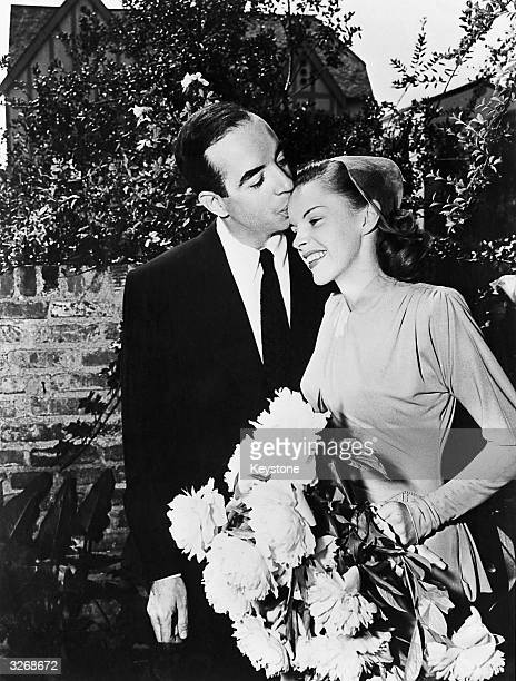 Film director Vincente Minnelli kisses singer and actress Judy Garland on the brow at their wedding