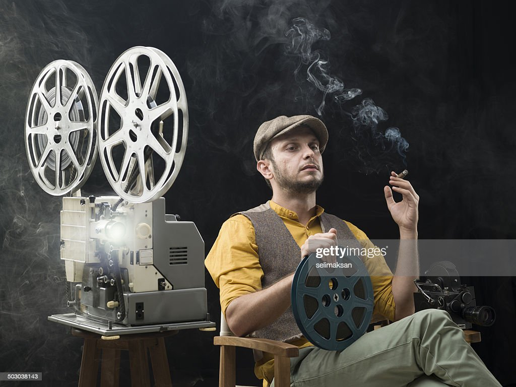 Film director watching his movie for the first time : Stock Photo