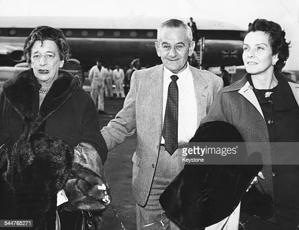 Film director William Wyler leaving an airplane with his wife and the wife of writer Alman Liazian at Rome Ciampino Airport November 12th 1960