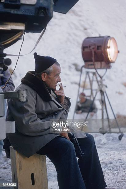 Film director William Wyler relaxing on the set of his western 'The Big Country'