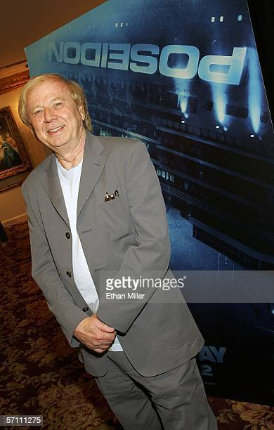 "Film director Wolfgang Petersen poses in front of a poster for his upcoming movie ""Poseidon"" at the Paris Las Vegas during ShoWest, the official..."