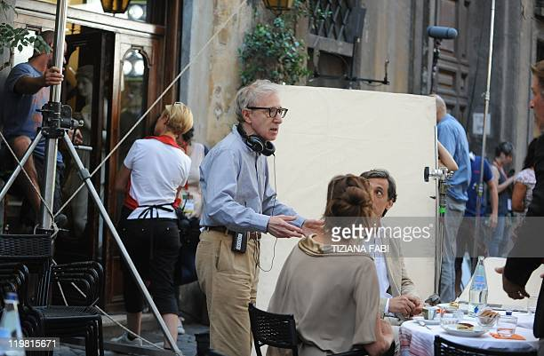 US film director Woody Allen speaks to US actor Alec Baldwin and US actress and model Carol Alt at a terrace at Piazza della Pace in central Rome...