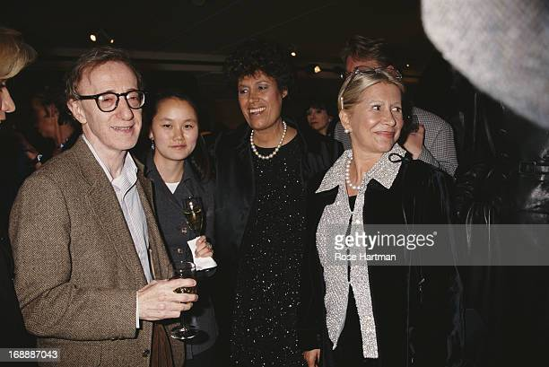 L R Film director Woody Allen with his wife Soon Yi Previn talking with Italian fashion designers Carla Fendi and Anna Fendi at the Fendi Honors...