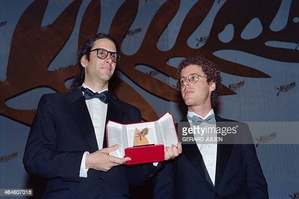 "Film directors Ethan and Joel Coen pose with the Palme d'Or for their film ""Barton Fink"" during the closing ceremony at the 44th edition of the..."