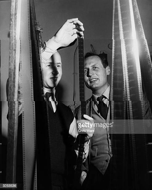 Film editor Harry Hasting of the BBC film unit showing rush takes to John Elliot the producer of a documentary programme about commercial advertising...