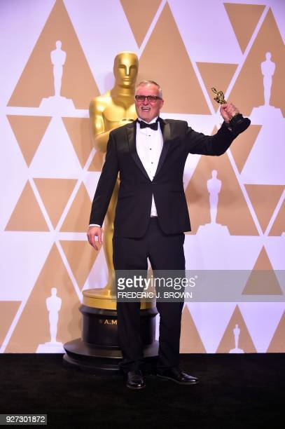 Film Editor Lee Smith poses in the press room with the Oscar for Best Film Editing for 'Dunkirk' during the 90th Annual Academy Awards on March 4 in...