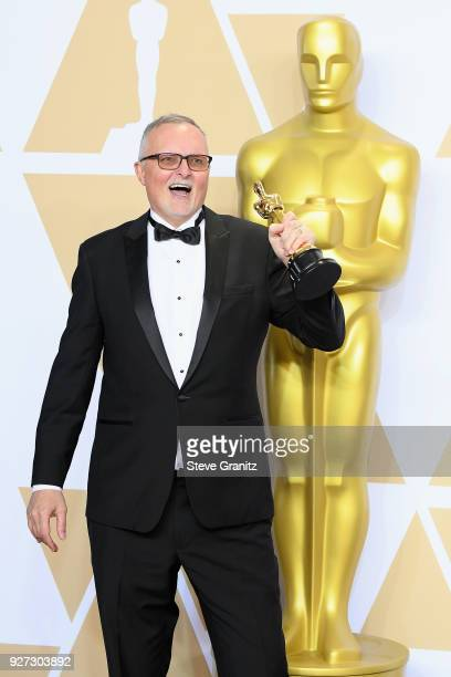 Film editor Lee Smith winner of the Film Editing award for 'Dunkirk' poses in the press room during the 90th Annual Academy Awards at Hollywood...