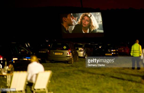 Film Enthusiasts enjoy an outdoor viewing of Hollywood blockbuster Top Gun at Harewood House on September 10 2011 in Leeds United Kingdom The drivein...