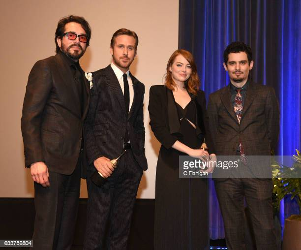 Film festival director Roger Durling actor Ryan Gosling actress Emma Stone and director Damien Chazelle pose onstage at the 32nd Santa Barbara...