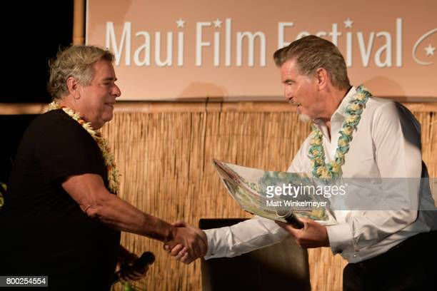 Film Festival founder Barry Rivers presents Pierce Brosnan the Pathfinder Award during the 'Celestial Cinema' on day three of the 2017 Maui Film...