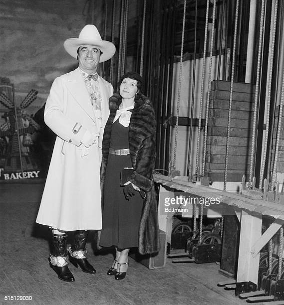 Film Folk at Benefit Show. Mr. And Mrs. Tom Mix are seen here at the Christmas Benefit Show, staged by a Los Angeles Newspaper, at the Shrine Civic...