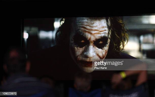 Film goers watch The Dark Knight featuring Heath Ledger during a public tribute outdoor movie night to the late actor at Burswood Park on February...