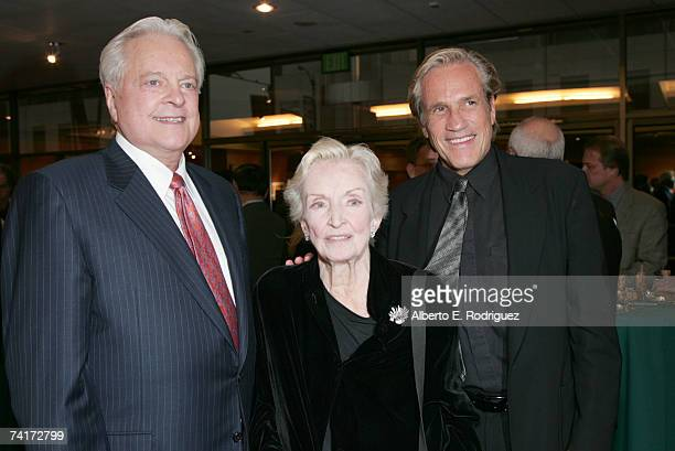 Film historian Robert Osborne actress Nina Foch and diretor Randall Kleiser attend the AMPAS Centennial Celebration for Barbara Stanwyck on May 16...