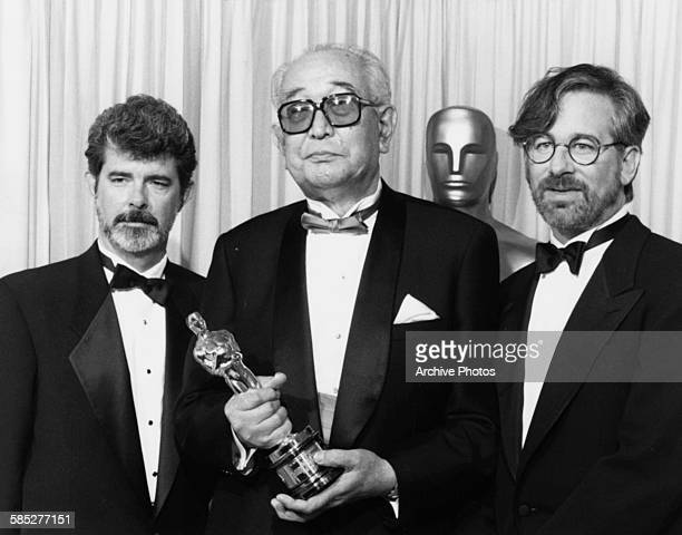 Film maker Akira Kurosawa holding his Honorary Oscar with presenters George Lucas and Steven Spielberg at the 62nd Academy Awards Los Angeles March...