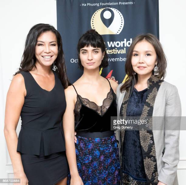 Film maker Gia Noortas Actress Tuba Buyukustun and AWFF Cofounder and Managing Director Asel Sherniyazova attend a reception as Angelina Jolie...