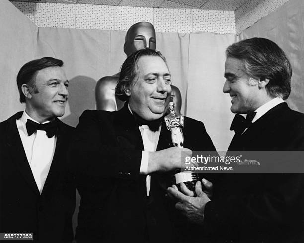 Film maker Henri Langlois holding his Honorary Oscar with presenters Gene Kelly and Jack Valenti at the 46th Academy Awards Los Angeles April 2nd 1974