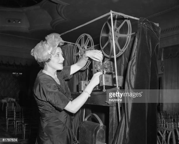 Film maker Rosie Newman threads a projector before screening her film 'Britain Through The War', in aid of the Victoria League charity, at the...