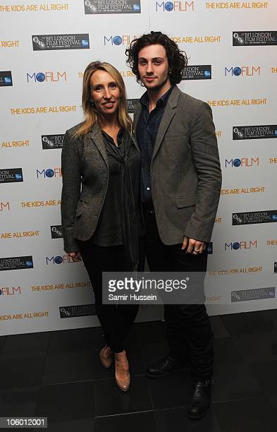 Film maker Sam TaylorWood and actor Aaron Johnson attend the premiere of 'The Kids Are Alright' during the 54th BFI London Film Festival at the Vue...