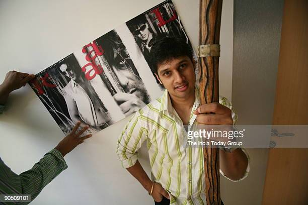 Film maker Soham Shah with a prop and posters of his film KAAL at his office in Mumbai Maharashtra India