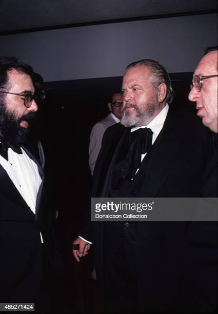 Film makers Francis Ford Coppola, Orson Welles and Paul Mazursky attend an awards dinner given by the National Alliance of Theatre Owners at the...