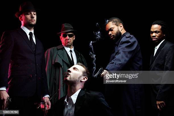 film noir gun shot with blood splatter - organised crime stock pictures, royalty-free photos & images