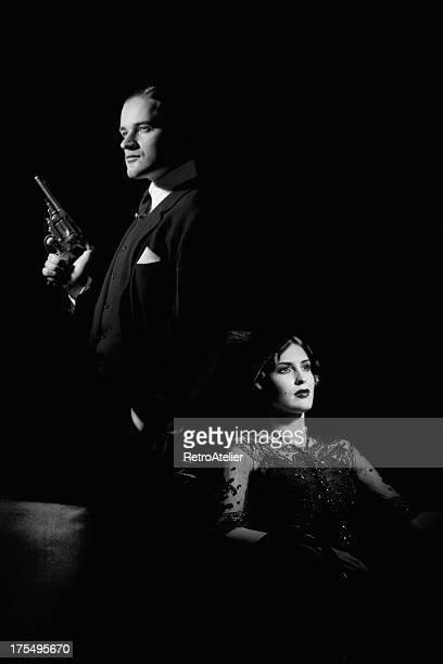 film noir style. dangerous couple - film noir style stock photos and pictures