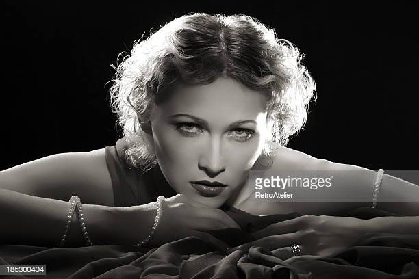 film noir style.diva with necklace - actress stock pictures, royalty-free photos & images