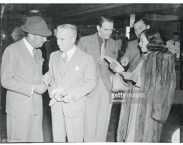 Film notables at Santa Anita Races Arcadia Calif Douglas Fairbanks Sr Charlie Chaplin Douglas Fairbanks Jr Adrian Bailey and Paulette Goddard doping...