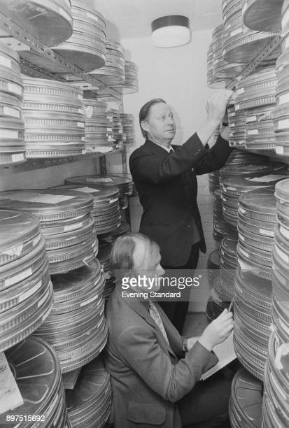 Film preservationists Harold Brown and David Price at work at the National Film Library, know today as BFI National Archive, UK, 18th April 1977.