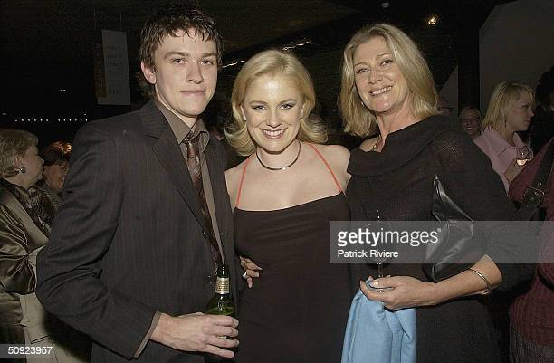 Film producer Abe Forsythe with girlfriend actress Helen Dalleymore and actress Tina Bursill attend the opening night of The Unlikely Prospect Of...