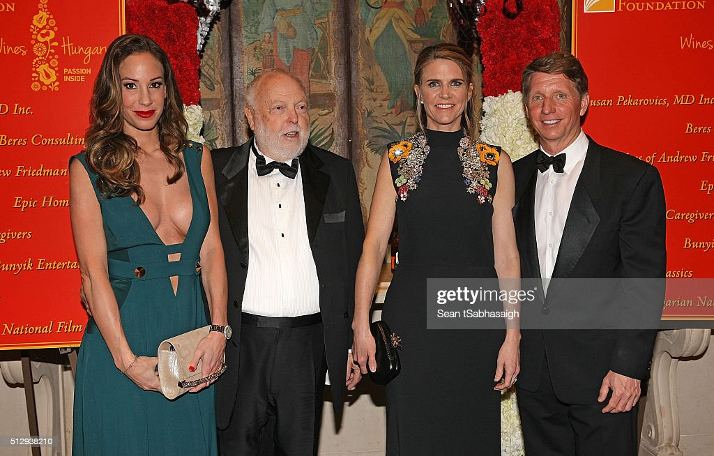 Film producer and Hungarian government film industry commissioner Andrew G Vajna (Ct Lt) and wife Timea Vajna (Lt) pose for a photo on the red carpet with United States ambassador to Hungary Colleen Bradley Bell and husband, TV producer and writer Bradley P. Bell to the Pre-Oscar Hungarians in Hollywood Gala celebrating the Academy Award nominated film Son of Saul at the Peninsula Hotel on February 27, 2016 in Beverly Hills, California.